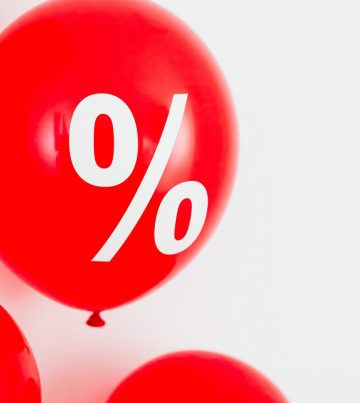 close up view of a red balloon with percentage symbol